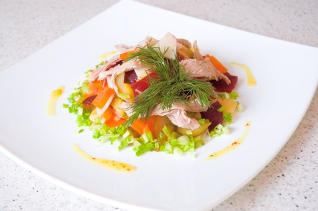 salad of beetroot, carrot, potato, green leek and meat photo