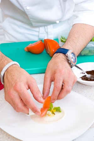 cooker: chef decorate plate with food