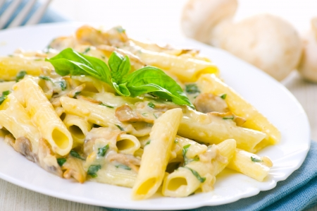 Penne pasta with mushroom and basil Stock Photo