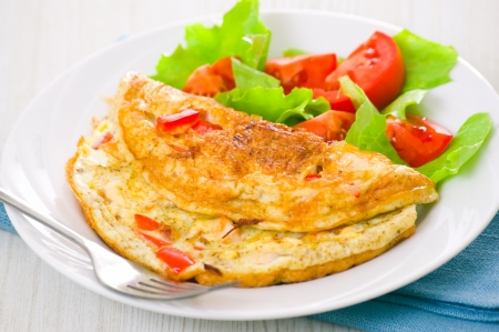 Omelet with vegetable salad photo