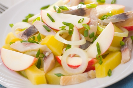 herring salad with apple and potato photo