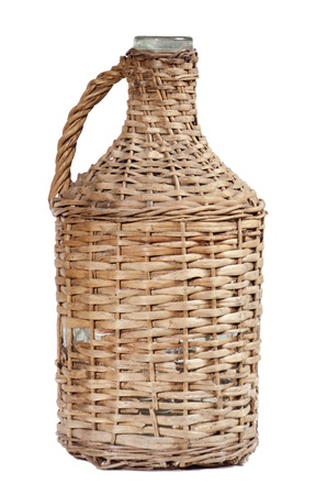 an old wicker bottle of wine, isolated on white  photo