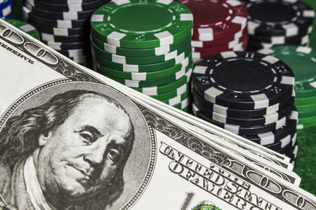 Poker chips with some dollars on the table Stock Photo