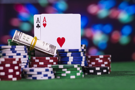 Two ace with a lot of poker chips (color background) Stock Photo