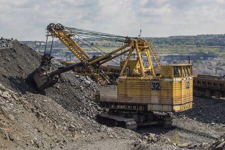 backhoe loader: Large backhoe loader in the iron quarry in Ukraine