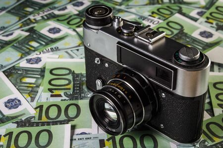 antiquarian: Old Soviet camera on a pile of euros