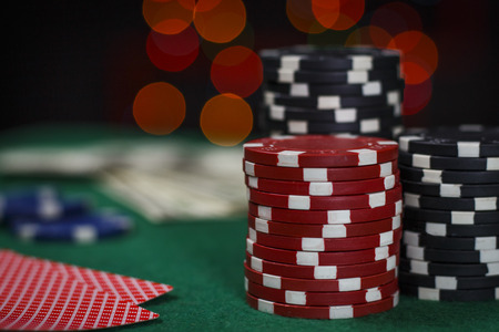 Poker chips and cards on the green table Stock Photo
