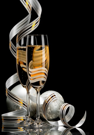 new year party: A glass of champagne, isolated on a black background.