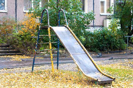 old childrens metal slide with peeling paint