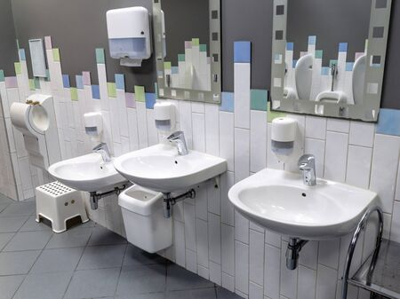 row of urinals in a public restroom