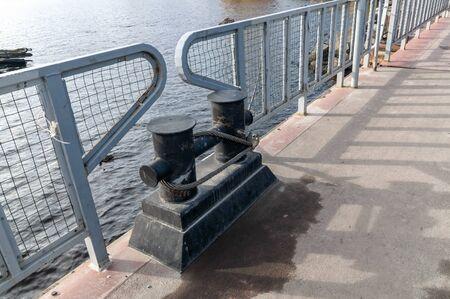 mooring bollard for small boats on a pontoon bridge Фото со стока - 135333525
