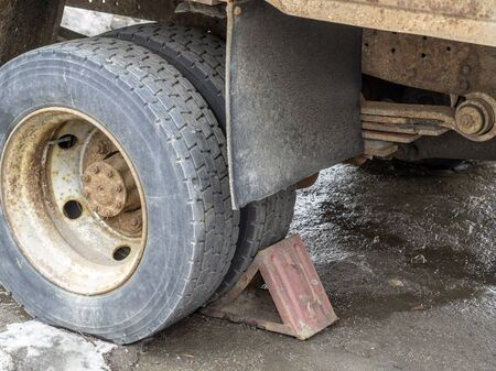 Wheel of an old truck locked. Old abandoned lorry