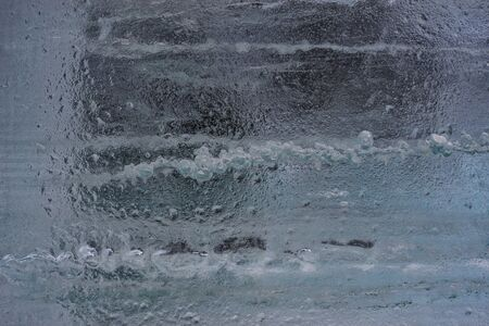 Awesome dark blue ice background. Background with empty space fot text or image. Фото со стока