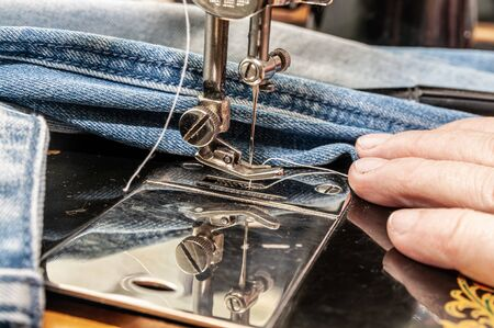 close up of sewing machine and item of clothing Фото со стока - 137187460