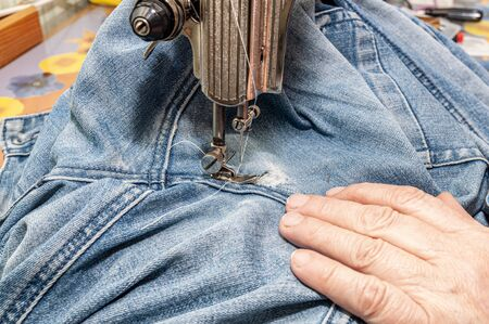 close up of sewing machine and item of clothing Фото со стока - 137187665