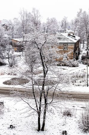 Winter landscape with snow covered trees and wooden buildings