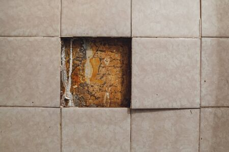 background with falling off tiled tiles in the bathroom Фото со стока - 138093269