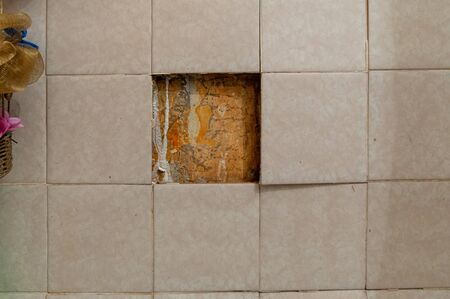background with falling off tiled tiles in the bathroom Фото со стока - 138093714