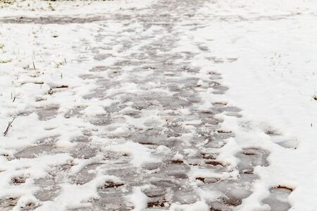 abstract background with human footprints in the snow