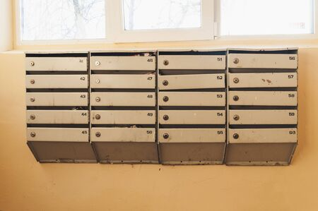 mailboxes in an apartment building against the window Фото со стока - 138097279