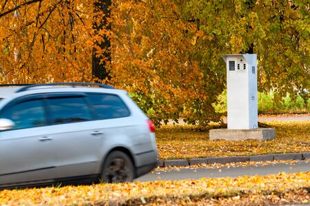 camera for fixing the speed mode and passing car. motion blur. autumn landscape