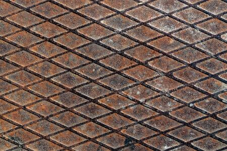 Rolled steel fluted sheet with rust and traces of time. rolled steel with a diamond pattern. 版權商用圖片