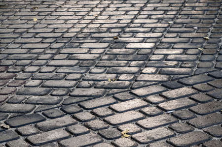 place paved with paving stones. gray background with paving stones Foto de archivo