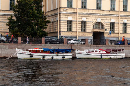 Saint Petersburg, Russia - 8 September 2020. several boats parked by the stone embankment
