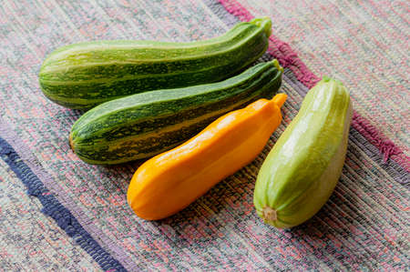 close-up of courgettes of different kinds on the table. Autumn harvest