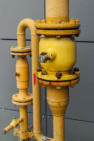 yellow pipes of the gas distribution system of an apartment building Фото со стока - 158364689
