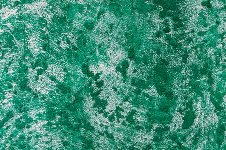 texture of the wall covered with relief plaster and painted green