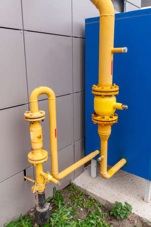yellow pipes of the gas distribution system of an apartment building Фото со стока