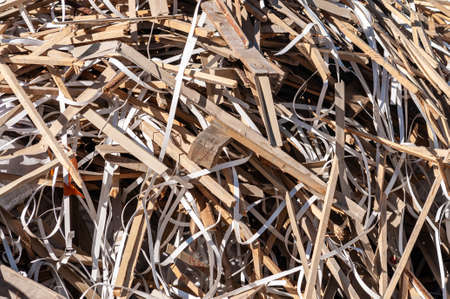 pile of garbage from broken wooden sticks, cardboard