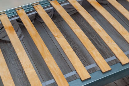 birch slats on the metal frame of the bed