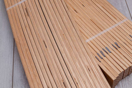 unpacked packaging of birch slats on the floor