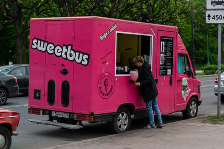 Saint Petersburg, Russia - 24 May 2019. Man buys cotton sweet in food truck Редакционное