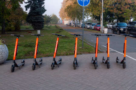 electric scooters stand in a row. electric scooter rental station on the street