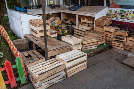 lots of empty wooden boxes on the street vegetable store