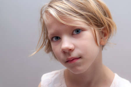 headshot of pretty young girl a little bit serious. High quality photo