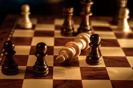 The game of chess is over. White King Defeated. High quality photo Фото со стока