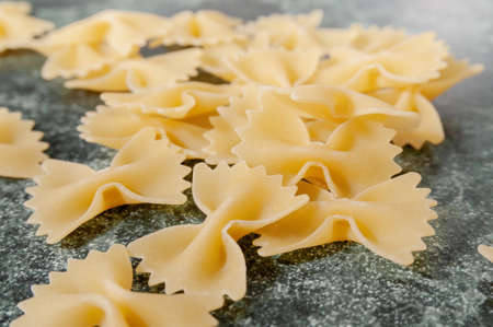 uncooked pasta farfalle on the table. High quality photo Фото со стока