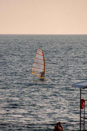 Windsurfer on Black sea in summer day.