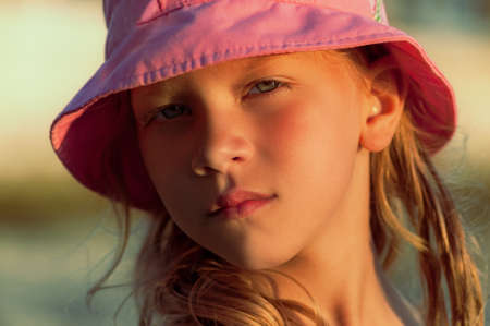 portrait of a little girl in a pink panama. High quality photo Фото со стока