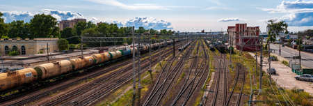 Saint Petersburg, Russia - 14 July 2019. panorama of railway tracks with freight trains