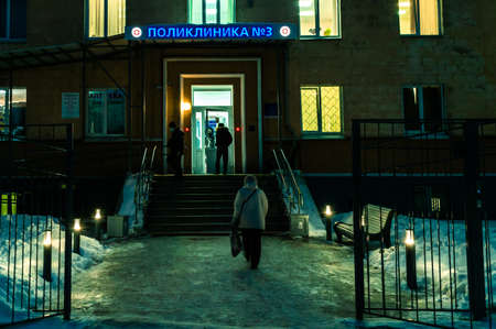 Petrozavodsk, Russia - 28 January 2021. people in front of the clinic in the early morning