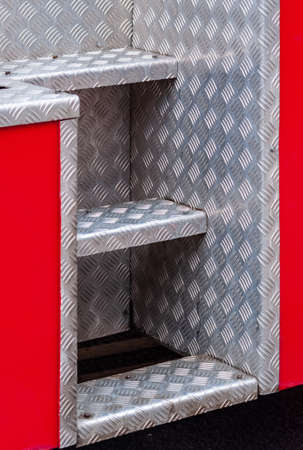 close-up of metal steps on fire truck. High quality photo