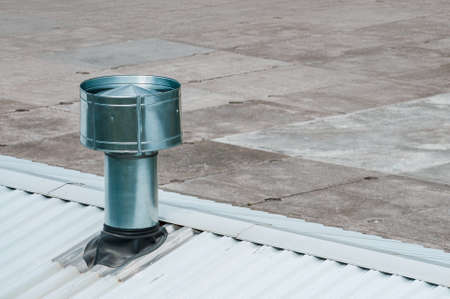 metal ventilation pipe on the roof. High quality photo