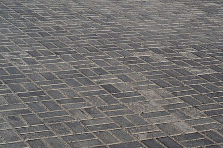 place paved with paving stones. gray background with paving stones Фото со стока