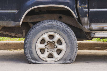 car with punctured tire. flat tire. High quality photo