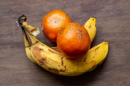 ugly fruits and vegetables. darkened bananas and tangerines